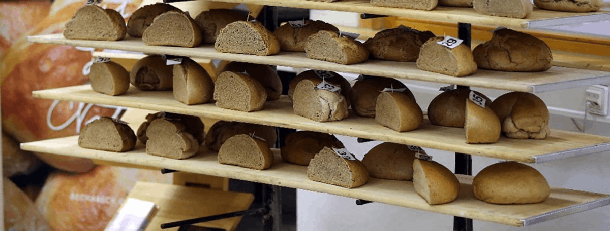 Shelves of bread made from different wheat varieties