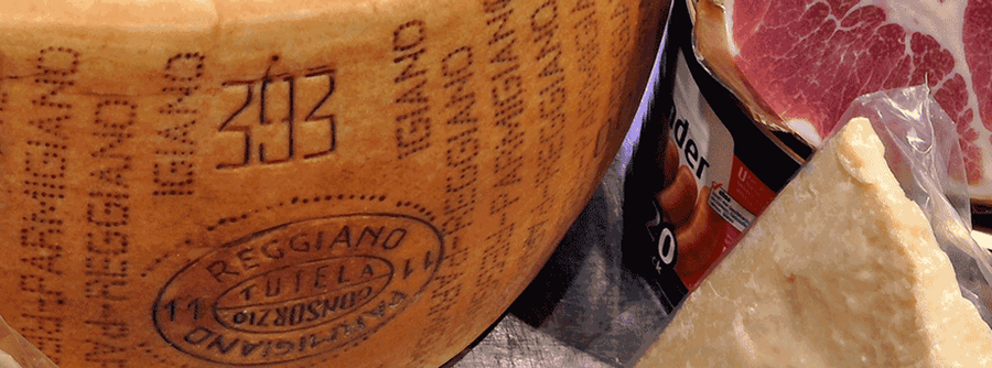 Markings on a block of certified Parmigiano-Reggiano cheese