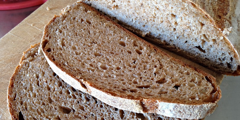 Slices of 100% wholewheat sourdough bread made with whole grain flour